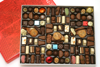 Image shows a large Historic Map of Zurich box filled with an assortment of chocolates, on a white background.